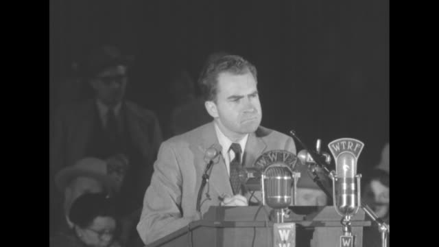 republican vice presidential candidate richard nixon standing at podium giving speech praising his running mate dwight eisenhower pan across to... - 1952 stock videos and b-roll footage