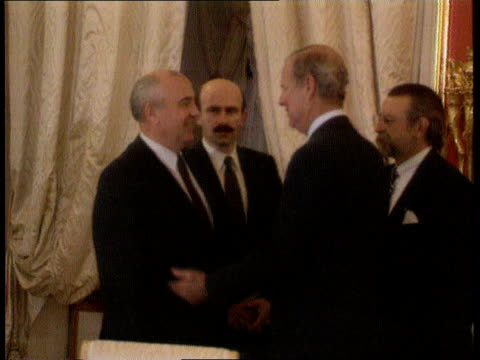 POLITICS Republics sign new Commonwealth treaty RUSSIAN FEDERATION Moscow St Catherine's Hall LMS Soviet Pres Mikhail Gorbachev shakes with Baker...