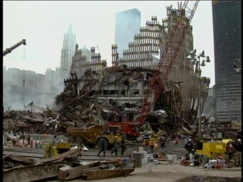 rescue and cleanup workers walk past wreckage at ground zero. - 2001 stock videos & royalty-free footage
