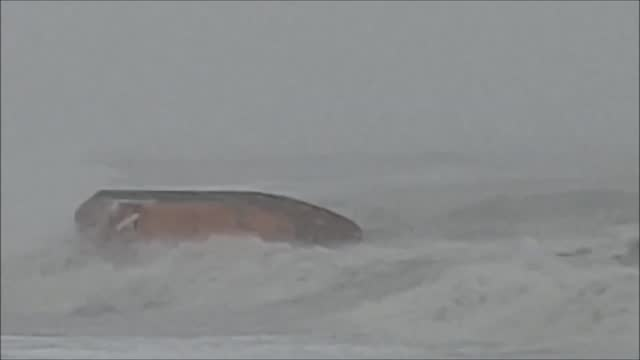 rescue boat nearly capsized on a mission to save a surfer who was caught in rough waters brought on by storm ciara off the coast of hastings,... - incidental people stock videos & royalty-free footage