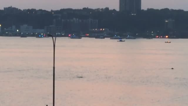 rescue crews search for the wreckage of a small plane that crashed into the hudson video looking west to newark nj - hudson river stock videos & royalty-free footage