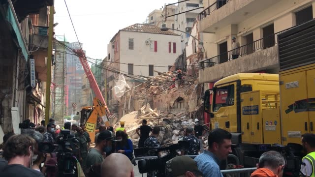 rescue efforts continued early friday after rescue workers detected a sign of life from under the rubble of a collapsed building in capital beirut on... - lebanon country stock videos & royalty-free footage