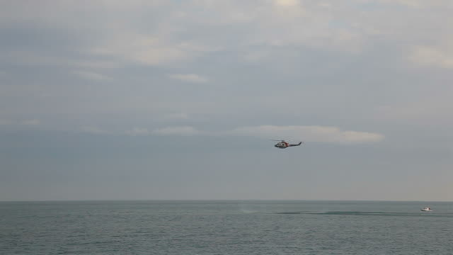 Rescue helicopter hovering over sea