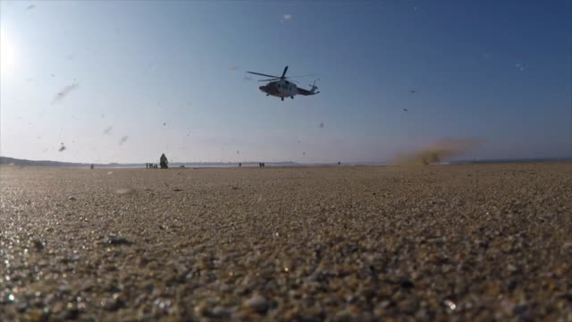 rescue helicopter taking off from philorth beach - helicopter stock videos & royalty-free footage