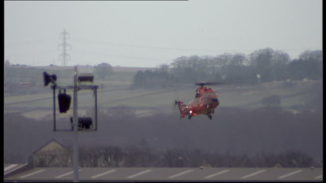 rescue operation launched after major security alert on north sea oil rig aberdeen ext rescue helicopter coming in to land police officers seen... - helicopter landing pads stock videos and b-roll footage