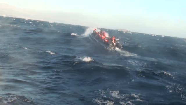 rescue operation of 40 illegal migrants rescued by coast guard command who were trying the to go to greece's lesbos island seen in a boat on the sea... - flüchtling stock-videos und b-roll-filmmaterial