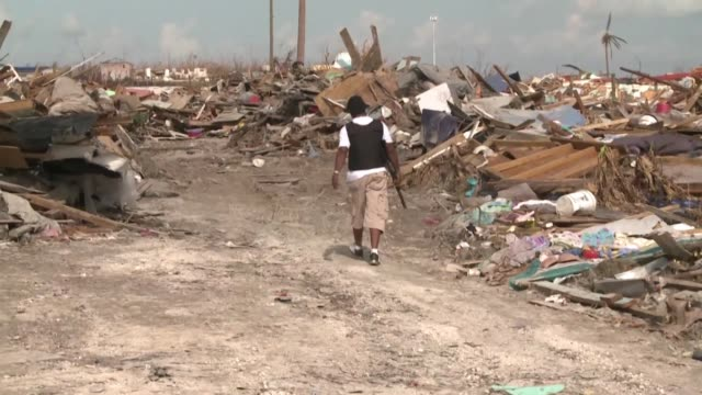 rescue personnel in abaco the bahamas continue the search for missing people survivors and corpses amid total destruction left behind by hurricane... - survival stock videos & royalty-free footage