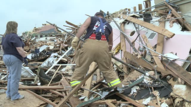 rescue, recovery efforts underway in joplin, missouri, businesses, churches, homes destroyed by 200 mile per hour winds of ef 5 tornado. vounteers... - 2011 stock videos & royalty-free footage
