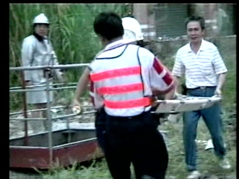 rescue service men carry injured child away from collapsed building on stretcher following earthquake chi chi 23 september 1999 - taiwan stock videos & royalty-free footage