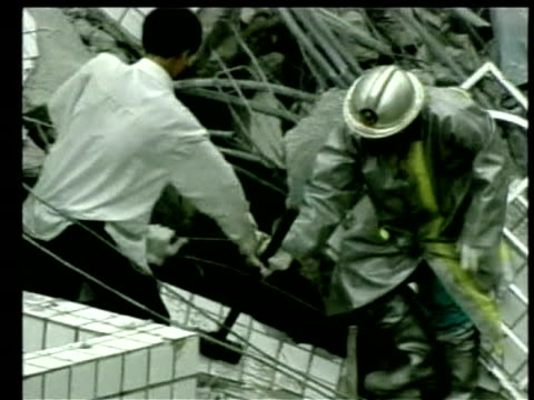 rescue servicemen and civilians desperately search through rubble for victims following earthquake chi chi 23 september 1999 - taiwan stock videos & royalty-free footage