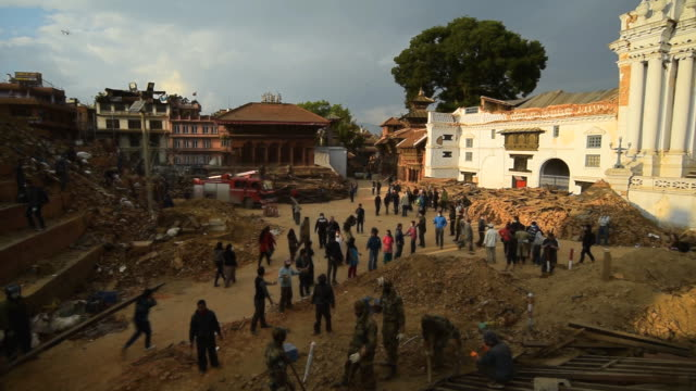 stockvideo's en b-roll-footage met kathmandu, nepal - april 29, 2015: rescue team at durbar square which was severly damaged after the major earthquake - aardbeving