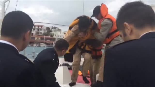 rescue team crew evacuate the survivors after a boat carrying illegal immigrants sank offshore datca mugla turkey on april 6 2015 at least four... - mugla province stock videos and b-roll footage