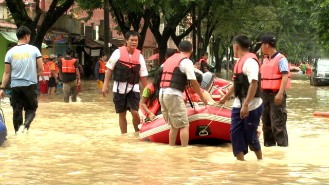 rescue team in flood crisis manila - rescue stock videos & royalty-free footage
