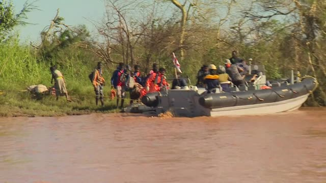 Rescue teams from the Indian Navy assisting people stranded by floodwater after Buzi Mozambique was hit by Cyclone Idai