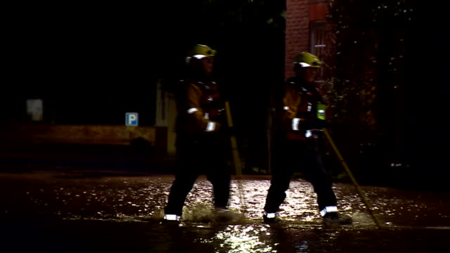 rescue teams helping people stranded by flooding in tenbury wells - small boat stock videos & royalty-free footage