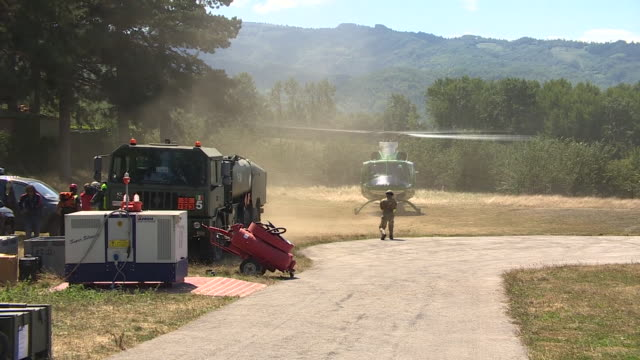 rescue teams including sniffer dogs boarding helicopters in amatrice italy to provide aid to victims of the devastating earthquakes - rubble stock videos & royalty-free footage