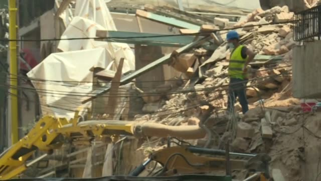 rescue teams keep up their search for survivors in beirut even as hopes raised by sensor readings of a pulse beneath the rubble of last month's blast... - fade in video transition stock videos & royalty-free footage