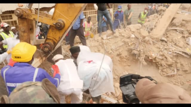 rescue teams look for survivors in jos central nigeria after a three storey residential building collapsed following torrential rain killing thirteen... - building storey stock videos and b-roll footage