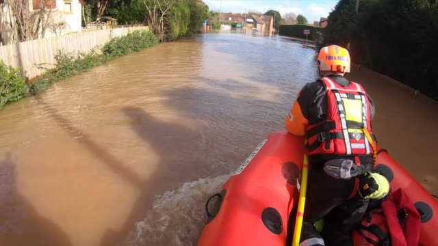 rescue teams rescuing residents from their houses due to flooding in after storm dennis in hereford - storm stock videos & royalty-free footage