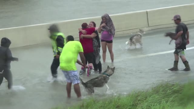 Rescue teams scramble to reach hundreds of Texans marooned on flooded streets in and around Houston before monster storm Harvey returns