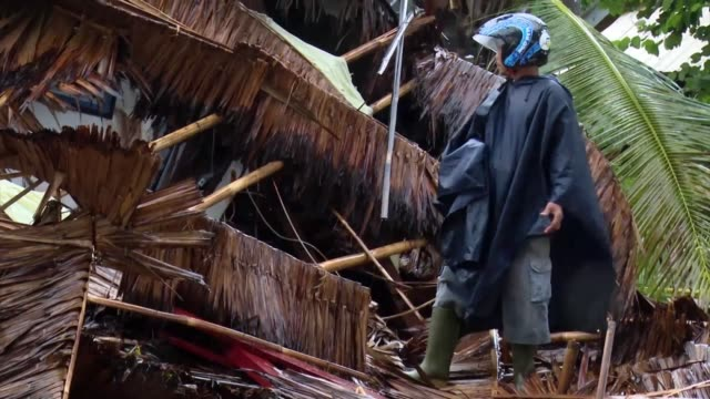rescue teams search for missing people amid flattened homes in indonesia as the death toll from saturday's volcano triggered tsunami rises to nearly... - indonesia stock videos & royalty-free footage