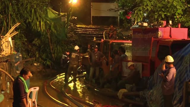 rescue teams searched for twelve boys and their football coach trapped in a flooded thai cave for nine days - football team stock videos & royalty-free footage