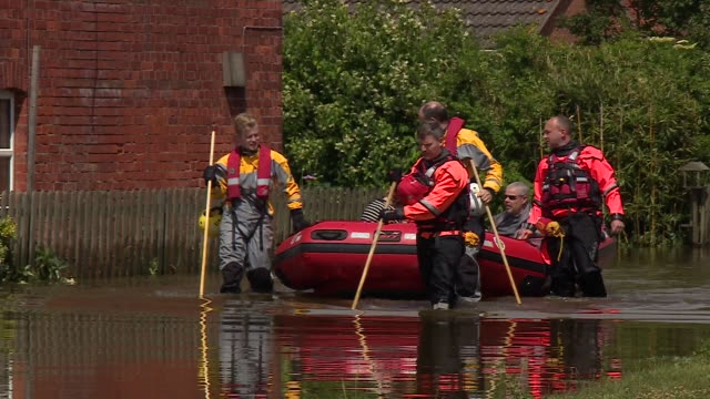 rescue teams with a dingy in wainfleet, lincolnshire, after serious flooding - rescue worker stock videos & royalty-free footage