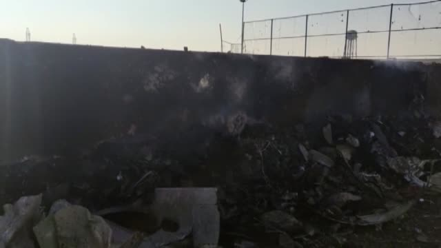 rescue teams work at the scene after a ukrainian plane carrying 176 passengers crashed near imam khomeini airport in the iranian capital tehran early... - 航空事故点の映像素材/bロール