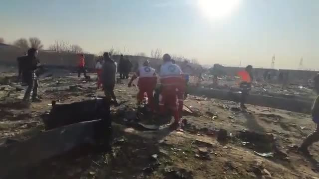 rescue teams work at the scene after a ukrainian plane carrying 176 passengers crashed near imam khomeini airport in the iranian capital tehran early... - イラン点の映像素材/bロール