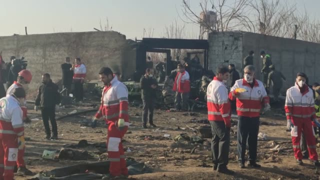 rescue teams work at the scene after a ukrainian plane carrying 176 passengers crashed near imam khomeini airport in the iranian capital tehran early... - teheran stock-videos und b-roll-filmmaterial
