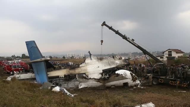 rescue teams work at the site of a plane crash at tribhuvan international airport in kathmandu, nepal on march 12, 2018. at least 49 passengers were... - kathmandu stock videos & royalty-free footage