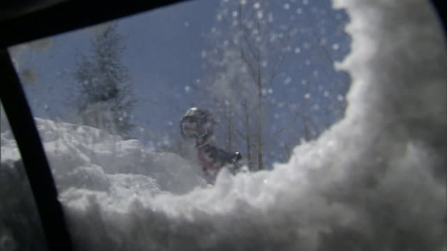 A rescue worker finds a snow-covered vehicle after a snow disaster.