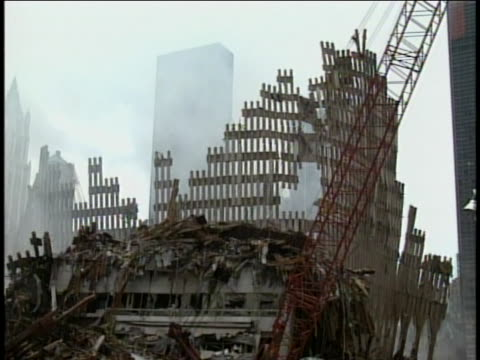 rescue workers and heavy machinery work on the rubble at ground zero in new york city after september 11, 2001. - rubble stock videos & royalty-free footage