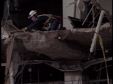 rescue workers examine the precarious remains of the murrah federal building in their search for bombing survivors. - oklahoma city bombing stock videos & royalty-free footage