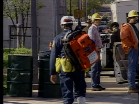 rescue workers gather near the site of the a.p. murrah federal building bombing. - oklahoma city bombing stock videos & royalty-free footage