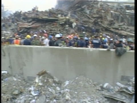 rescue workers, including nyc police and firefighters, sift through the rubble of the world trade center towers. - 2000s style stock videos & royalty-free footage