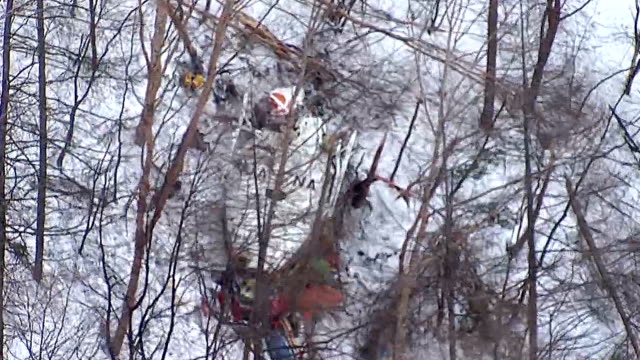Rescue workers on March 6 recovered the other six victims from the wreckage of a Nagano prefectural rescue helicopter in the snowcovered mountains in...