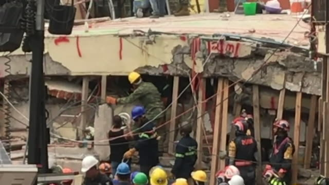rescue workers on the scene of the enrique rébsamen school in mexico city it is announced that all efforts will be focussed on finding a 13yearold... - earthquake stock videos and b-roll footage