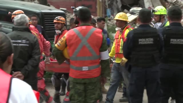 Rescue workers pulled a body Friday from a collapsed building belonging to the working class neighbourhood of Tlalpan as the suffering country passed...