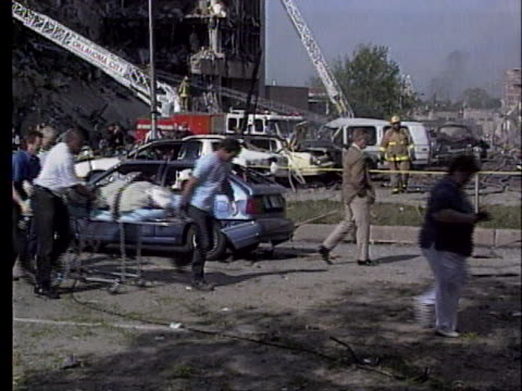 rescue workers push stretchers with casualties in the oklahoma city bombing aftermath. - oklahoma city bombing stock videos & royalty-free footage