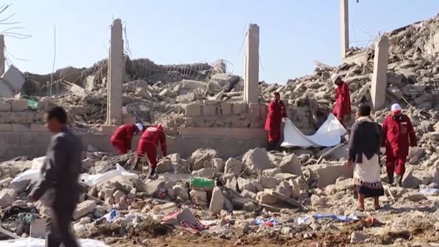 rescue workers recover bodies from the rubble of a houthi detention center destroyed by saudi-led airstrikes in dhamar province, southwestern yemen... - air raid stock videos & royalty-free footage