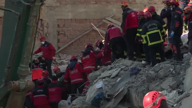 rescue workers retrieve a body from the rubble of a building destroyed in friday's earthquake in elazig, eastern turkey on january 26, 2020. the... - friday stock videos & royalty-free footage