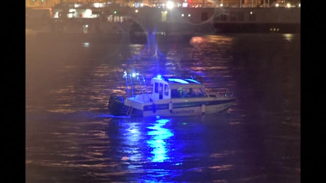 rescue workers search for survivors after the hungarian hableany riverboat capsized following a collision on the danube river in budapest - budapest stock videos & royalty-free footage