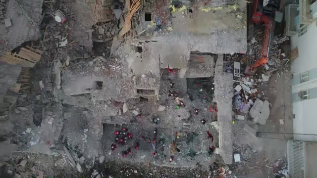rescue workers search for survivors in the rubble of a collapsed building after a 6.8-magnitude earthquake in mustafa pasa neighborhood of turkey's... - earthquake stock videos & royalty-free footage