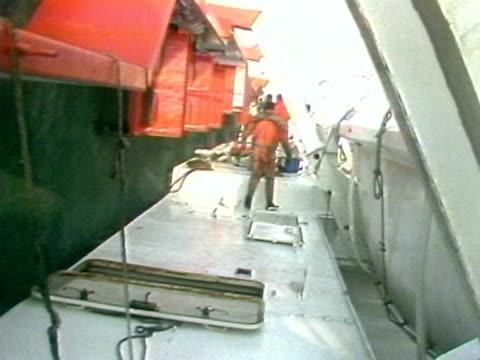 stockvideo's en b-roll-footage met rescue workers search the capsized zeebrugge ferry for survivors - ramp veerboot zeebrugge 1987