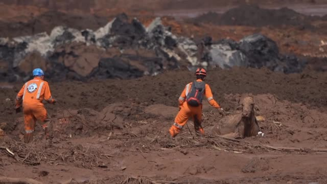 rescue workers search through mud for the 250 people still missing after a dam collapsed in the brazilian state of minas gerais - ruined stock videos & royalty-free footage