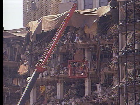 rescue workers search through the debris left by the bombing of the a.p. murrah federal building. - oklahoma city bombing stock videos & royalty-free footage