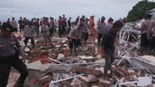 rescue workers searching for survivors and removing dead bodies after a devastating tsunami in carita indonesia - rubble stock videos & royalty-free footage