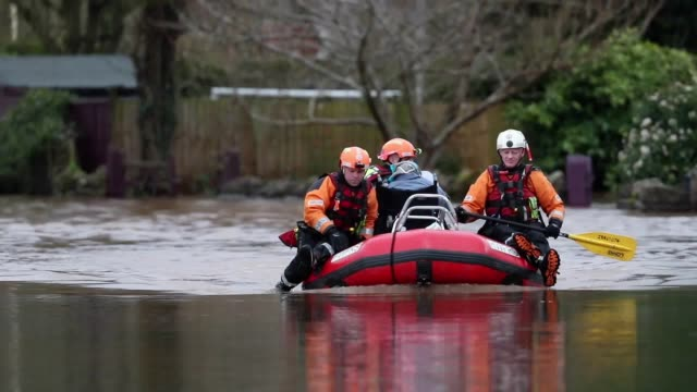 rescue workers stand in floodwater that surrounds the village of whitchurch and hampton bishop in herefordshire, after the river wye burst its banks... - herefordshire stock videos & royalty-free footage