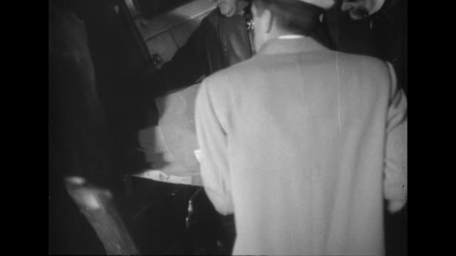 rescue workers transfer bodies at the crash site of national airlines flight 101 in elizabeth new jersey - 1952 stock videos & royalty-free footage